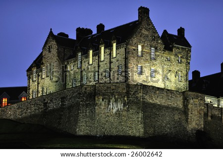 Edinburgh Castle, illuminated at nightfall, in winter from the north west. - stock photo