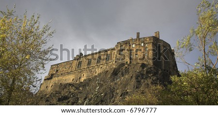 Edinburgh Castle In Scotland (as seen from The Grassmarket area of the city) - stock photo