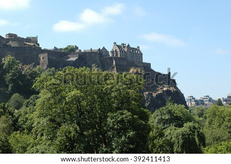 Edinburgh castle observed from Regent gardens - stock photo