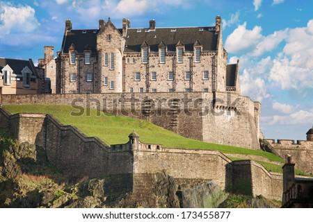 Edinburgh castle on a sunny day with a nice cloudscape - stock photo