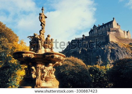 Edinburgh castle with fountain as the famous city landmark. United Kingdom. - stock photo