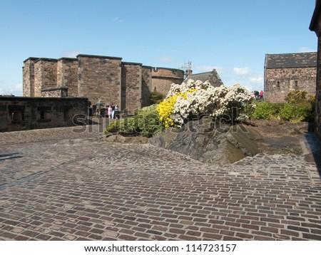 EDINBURGH, SCOTLAND - JULY 30: Edinburgh Castle, Scotland's most visited paid tourist attraction on July 30, 2009 in Edinburgh, Scotland. - stock photo