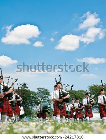 Edinburgh, Scotland - June 18, 2005 - Scottish bagpipers parade - stock photo