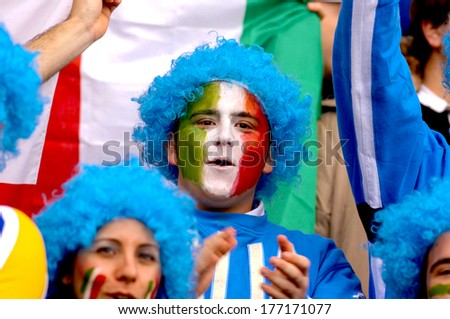EDINBURGH, SCOTLAND-MARCH 26, 2007: Italian masked fans wearing a blue wig, support the italian team ,during the Six Nations Rugby Tournament match Scotland vs Italy. - stock photo