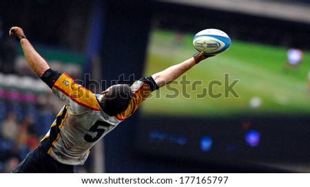 EDINBURGH, SCOTLAND -MARCH 26, 2007: Scottish Rugby player catching the ball during the Six Nations Tournament match Scotland vs Italy. - stock photo