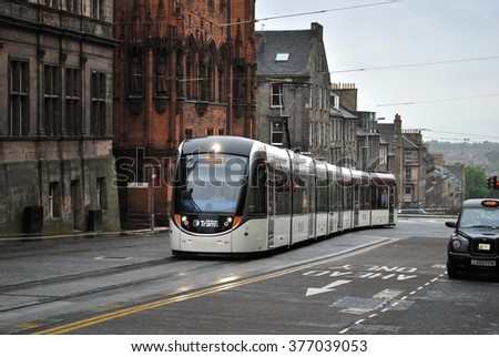 EDINBURGH, SCOTLAND - MAY 31. The new Edinburgh tram system linking the airport with York Place opened on May 31, 2014 in Edinburgh, Scotland  - stock photo