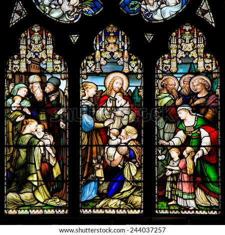 EDINBURGH, SCOTLAND - OCTOBER 02, 2014: Stained glass window illustrated Bible stories in the  St Giles' Cathedral of Edinburgh, Scotland, UK.  - stock photo