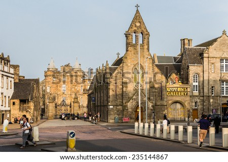 Edinburgh, Scotland - September 13, 2014: the Royal Mile's East end gathers two of the most visited tourist atractions in the city: the Palace of Holyroodhouse and The Queen's Gallery. - stock photo