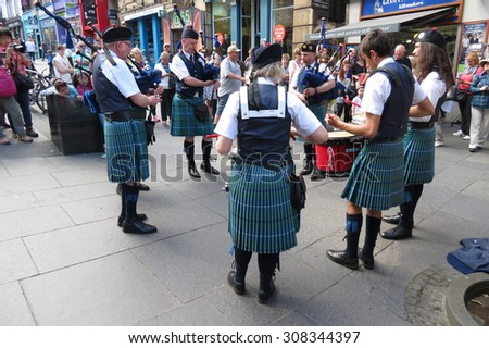 EDINBURGH, SCOTLAND, UK - CIRCA AUGUST 2015: Bagpipers performing on the royal Mile at the Fringe Festival - stock photo