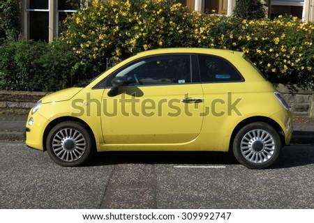 EDINBURGH; SCOTLAND, UK - CIRCA AUGUST 2015: yellow FIAT 500 car (new model) in a street of the city centre. - stock photo