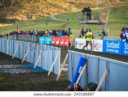 EDINBURGH, SCOTLAND, UK - January 10, 2015 - Japheth Korir of Kenya crosses the finish line in second place in the Men's Invitational 4k race at the Great Edinburgh Cross Country Run. - stock photo