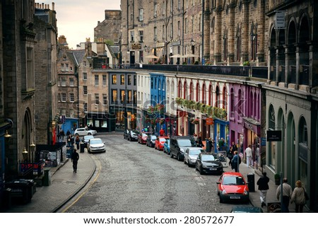 EDINBURGH, UK - OCT 8: City street view with traffic on October 8, 2013 in Edinburgh. As the capital city of Scotland, it is the largest financial centre after London in the UK. - stock photo
