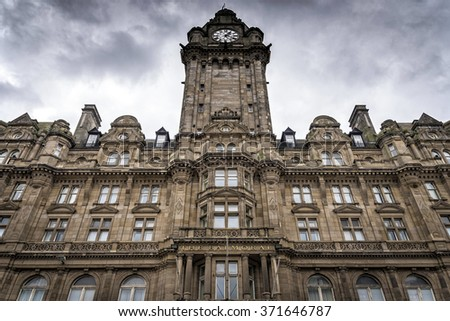 Edinburgh, United Kingdom - August 15, 2014: View of the Balmoral Hotel facade. Balmoral is a luxury five-star property and landmark in Edinburgh, Scotland. It is located in the heart of the city. - stock photo