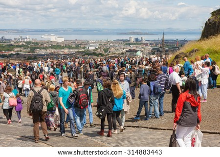 EDINBURGH, UNITED KINGDOM - JULY 24, 2015: unknown visitors gather for the one o'clock gunshot at Edinburgh Castle. With over 1.4 million visitors a year, the castle is a major tourist attraction. - stock photo