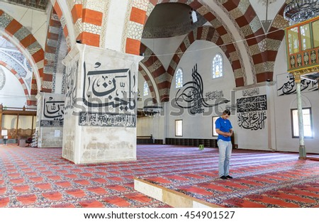 EDIRNE - TURKEY, JULY 12: Undefined muslims prayer in Edirne Old Mosque on july 12, 2016. The Old Mosque is an early 15th century Ottoman mosque in Edirne, Turkey - stock photo