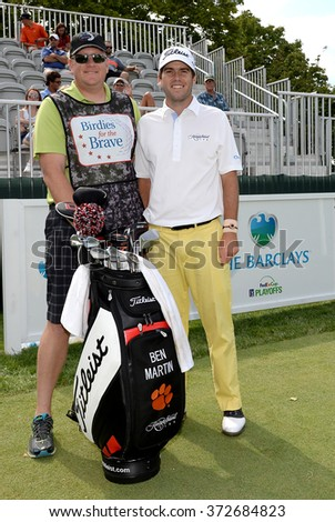 EDISON,NJ-AUGUST 26:Ben Martin (r) with his Military Caddie during the Barclays Pro-Am held at the Plainfield Country Club in Edison,NJ,August 26,2015. - stock photo