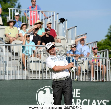 EDISON,NJ-AUGUST 30:Charley Hoffman watches his shot during the final round of the Barclays Tournament held at the Plainfield Country Club in Edison,NJ,August 30,2015. - stock photo