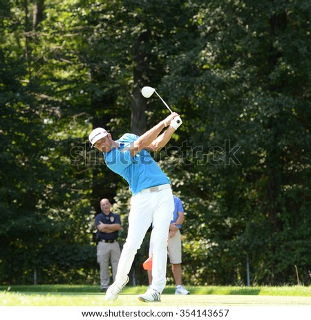 EDISON,NJ-AUGUST 25:Dustin Johnson watches his shot during the Barclays Tournament practice rounds held at the Plainfield Country Club in Edison,NJ,August 25,2015. - stock photo