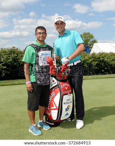 EDISON,NJ-AUGUST 26:Gary Woodland (r) with his Military Caddie during the Barclays Pro-Am held at the Plainfield Country Club in Edison,NJ,August 26,2015. - stock photo