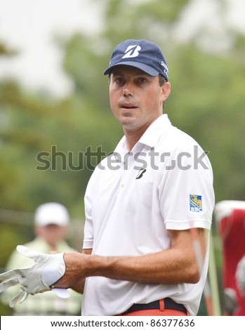 EDISON,NJ-AUGUST 27: Golfer Matt Kuchar takes a look at the fairway during the final round of the Barclays Tournament held at the Plainfield Country Club on August 27,2011 in Edison,NJ. - stock photo
