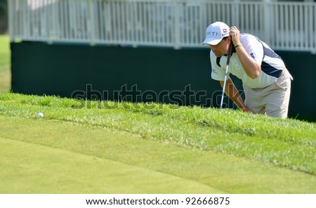 EDISON,NJ-AUGUST 26:Golfer Padraig Harrington lines up his putt from the rough during the second round of the Barclays Tournament held at the Plainfield Country Club on August 26, 2011 in Edison, N.J. - stock photo