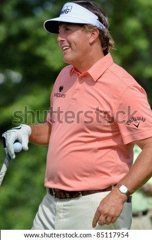 EDISON,NJ-AUGUST 24: Golfer Phil Mickelson waits to tee off during the Barclays pro-am held at the Plainfield County Club on August 24,2011 in Edison,NJ. - stock photo