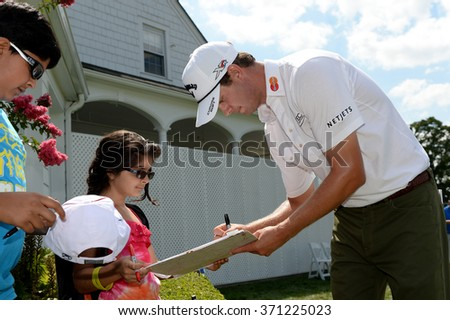 EDISON,NJ-AUGUST 26:Harris English stops to give a fan his autograph during the Barclays Pro-Am held at the Plainfield Country Club in Edison,NJ,August 26,2015. - stock photo