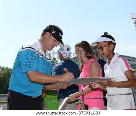 EDISON,NJ-AUGUST 25:Jason Bohn signs autographs for his fans during the Barclays Tournament practice round held at the Plainfield Country Club in Edison,NJ,August 25,2015. - stock photo