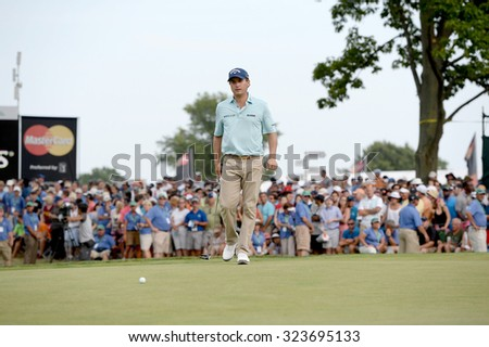 EDISON,NJ-AUGUST 30: Kevin Kisner lines up his putt at the 18th hole during the final round of the Barclays held at the Plainfield Country Club in Edison,NJ,August 30,2015. - stock photo