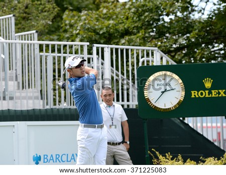 EDISON,NJ-AUGUST 26:Sangmoon Bae watches his shot during the Barclays Pro-Am held at the Plainfield Country Club in Edison,NJ,August 26,2015. - stock photo