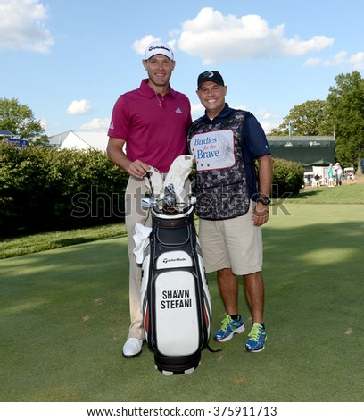 EDISON,NJ-AUGUST 26:Shawn Stefani (L) with his Military Caddie during the Barclays Pro-Am held at the Plainfield Country Club in Edison,NJ,August 26,2015. - stock photo