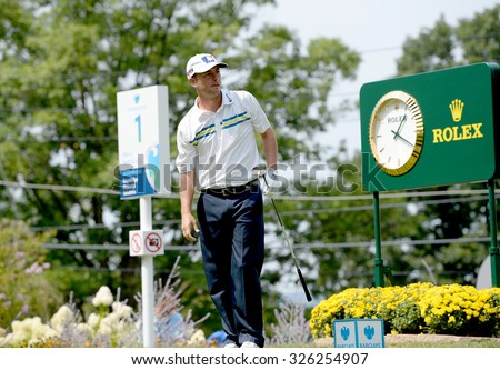 EDISON,NJ-AUGUST 30:Spencer Levin watches his shot from the 1st Tee during the final round of the Barclays Tournament held at the Plainfield Country Club in Edison,NJ,August 30,2015. - stock photo