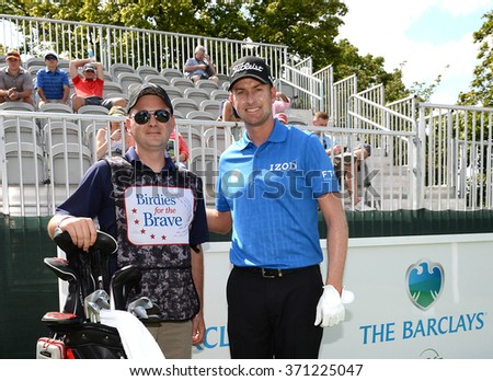 EDISON,NJ-AUGUST 26:Webb Simpson (r) with his Military Caddie during the Barclays Pro-Am held at the Plainfield Country Club in Edison,NJ,August 26,2015. - stock photo