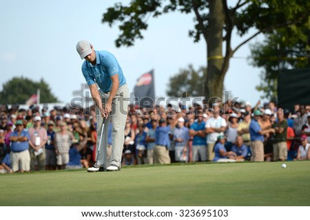 EDISON,NJ-AUGUST 30: Zach Johnson watches his putt at the 18th hole during the final round of the Barclays tournament held at the Plainfield Country Club in Edison,NJ,August 30,2015. - stock photo