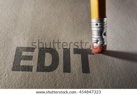Edit text being erased by a pencil -- proofreading and editing concept                                - stock photo