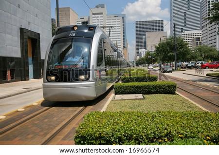Editorial: Houston Subway Speeding through patch of greenery - stock photo