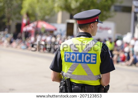 EDMONTON, AB, CANADA-July 18, 2014: Edmonton Police Officer as seen at the K-Days Parade on July 18th, 2014.  - stock photo