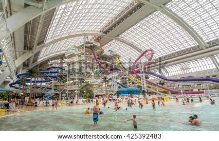 EDMONTON, CANADA - MAY 21: West Edmonton Mall water park attraction on May 21, 2016 in Edmonton, Alberta. The West Edmonton Mall was once the largest mall in the world. - stock photo