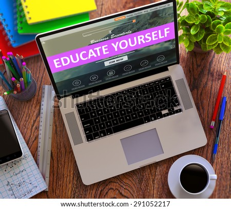 Educate Yourself Concept. Modern Laptop and Different Office Supply on Wooden Desktop background. - stock photo