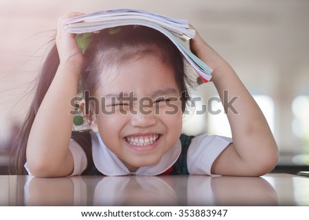education and school concept -A asian(japan, chinese, korea) pretty girl hold a book and reading - stock photo