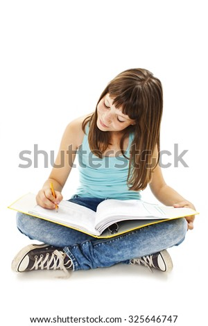 Education and school concept - little student girl sitting on floor and reading book.  Isolated on white background - stock photo