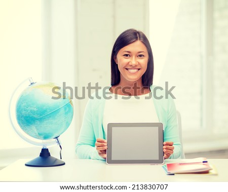 education and school, travel concept - female teacher with globe and tablet pc - stock photo
