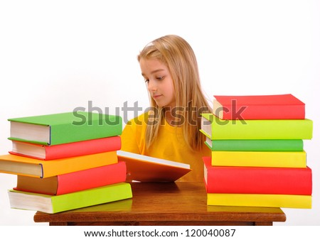 Education - beautiful girl reading a book surrounded by books, on white background - stock photo