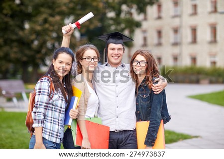 education, campus, friendship, graduation and people concept - group of happy teenage students with diploma school folders - stock photo
