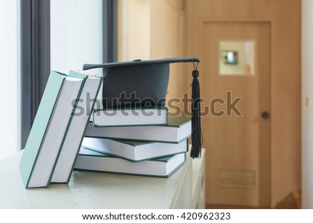 education cap and books,education concept - stock photo