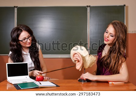 Education concept. Back to school. The teacher explains the structure of the pupil of the human ear. Anatomy Lesson. - stock photo