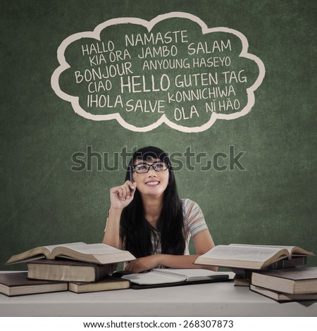 Education concept: female college student learn multilanguage at class - stock photo