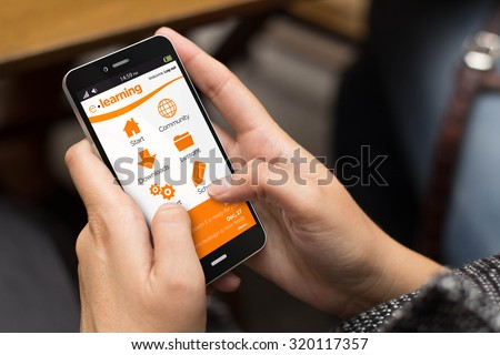education concept: girl using a digital generated phone with e-learning site on the screen. All screen graphics are made up. - stock photo