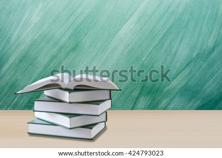 education concept,open book with green chalkboard,green chalkboard and education concept,book on desk for education concept - stock photo