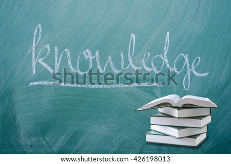education concept,open book with knowledge font on green chalkboard - stock photo